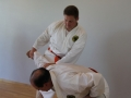 Knee to ribcage defense against blow to the head