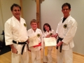 Very happy new colored belt brother and sister!
